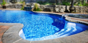circular shaped pool with stone surround